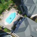 aerial view of building and pool