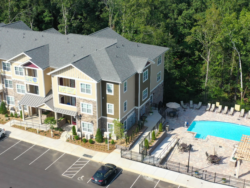 aerial view of apartment building with pool